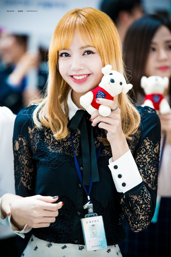BlackPink's Lisa holding a stuffed toy