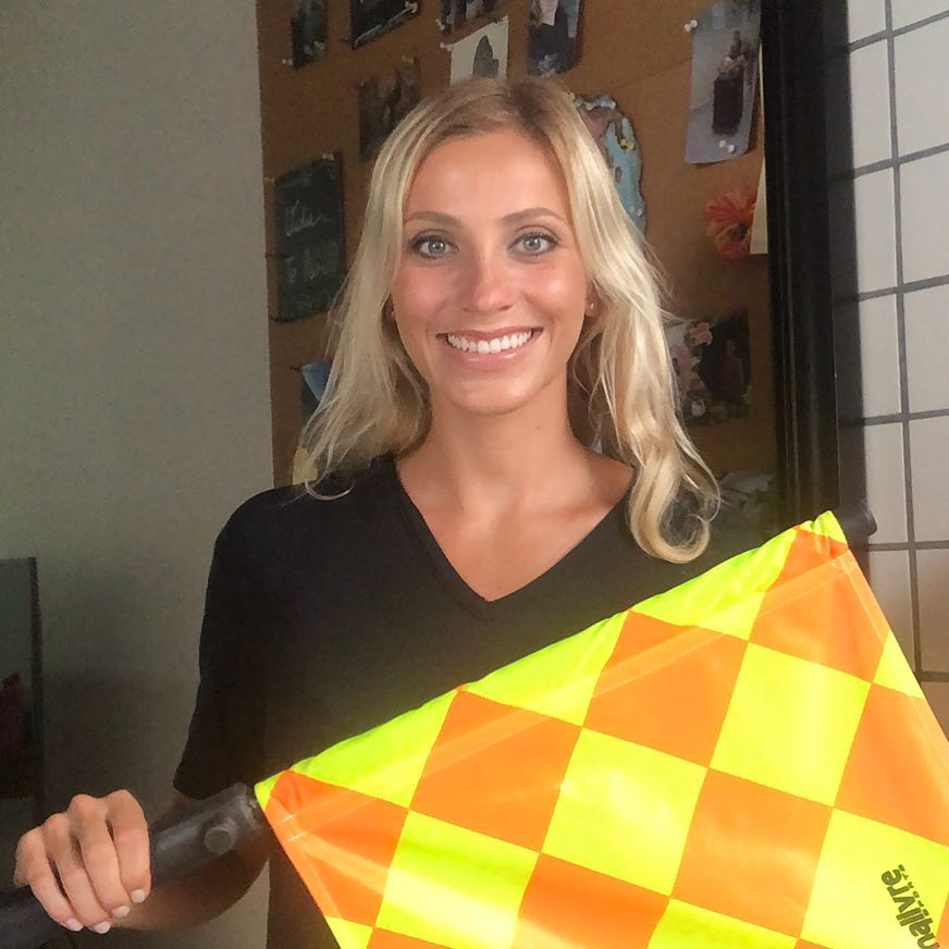 Fernanda Colombo posing with the offside flag