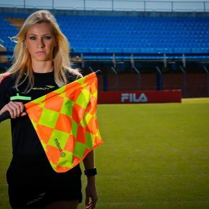 Fernanda Colombo holding the offside flag